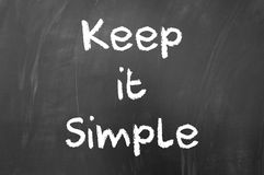 keep-simple-quote-written-white-chalk-blackboard-48583486